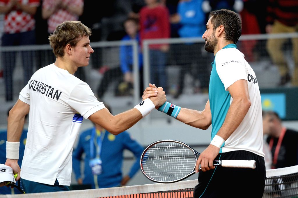VARAZDIN, April 7, 2018 - Dmitry Popko (L) of Kazakhstan shakes hands with Marin Cilic of Croatia after the Davis Cup singles at World Group quarterfinal between Croatia and Kazakhstan in Varazdin, ...