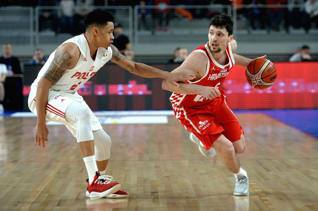 VARAZDIN, Feb. 23, 2019 - A.J. Slaughter (L) of Poland vies with Toni Katic of Croatia  during the FIBA Basketball World Cup 2019 European Qualifiers between Croatia and Poland in Varazdin, Croatia, ...