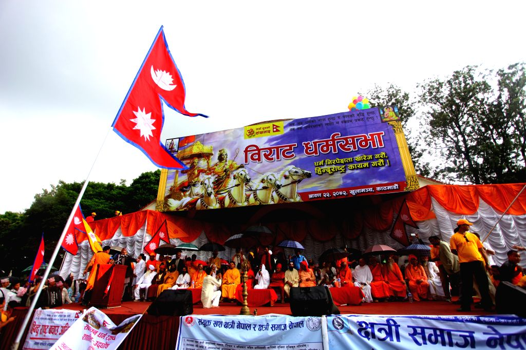 Various religious leaders attend a mass gathering demanding Nepal declared to be as a Hindu nation in new upcoming constitution in Kathmandu, Nepal, Aug. 7, 2015. ...