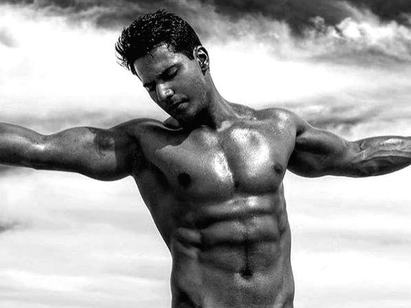 Varun Dhawan flaunts washboard abs.