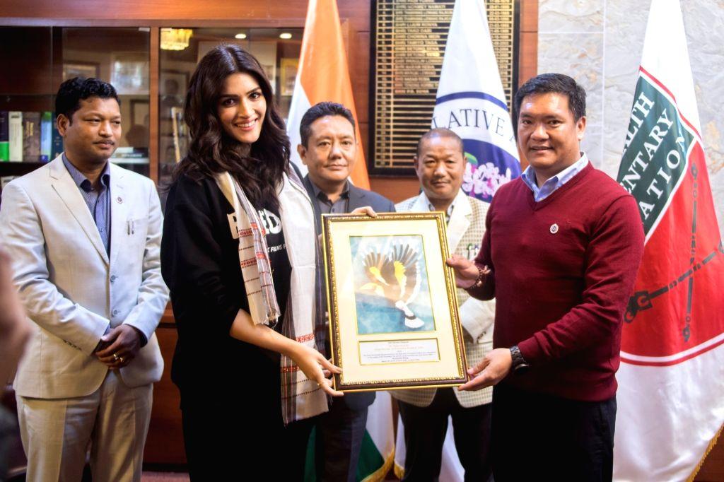 Varun Dhawan, Kriti Sanon meet Arunachal CM.(photo:Twitter)