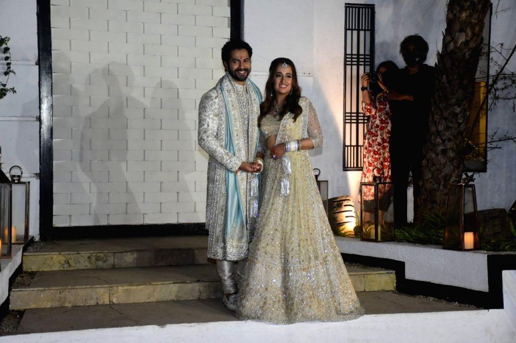 Varun Dhawan shares first image of wedding with Natasha Dalal .