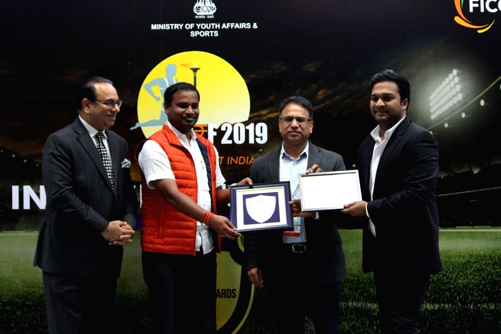 Vedanta Sports President Annanya Agarwal receives the award for 'Best Organisation Contributing in Sports' at FICCI India Sports Awards in the presence of FICCI President Sandip Somany, ... - Tusharkanti Behera
