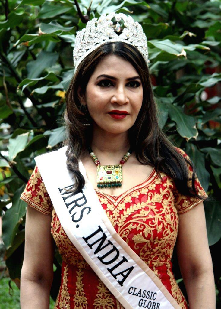 Veena Jain, who represented India at Mrs Globe 2017 during a press conference in Bengaluru on July 6, 2017. - Veena Jain
