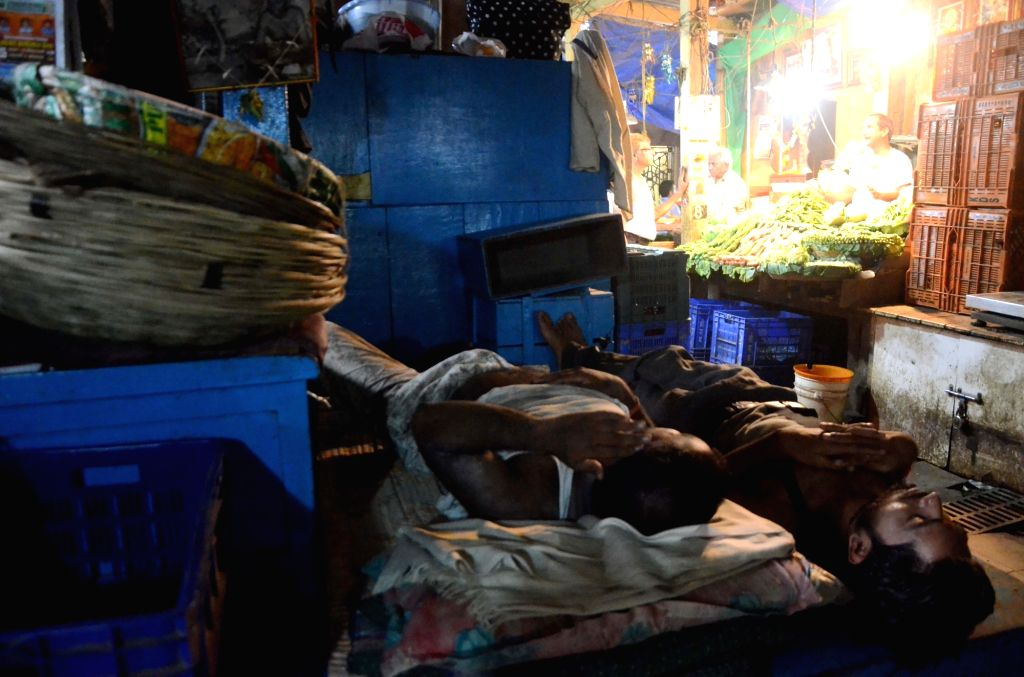 Vegetable mongers enjoy their siesta as their stocks dry up due to farmer's strike in Mumbai, on June 3, 2017.