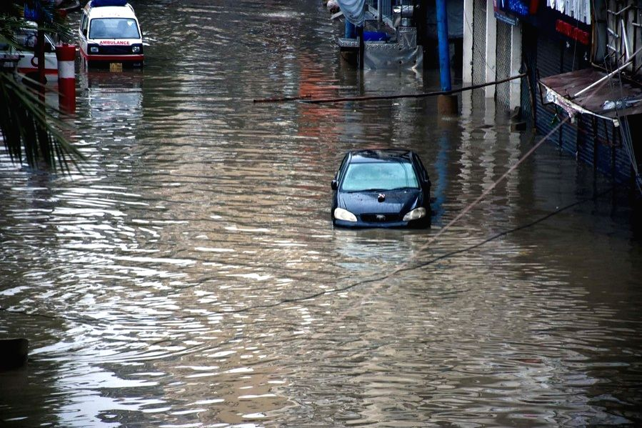 Vehicles are seen in floodwater after a heavy rain in southern Pakistani port city of Karachi on Aug. 27, 2020.