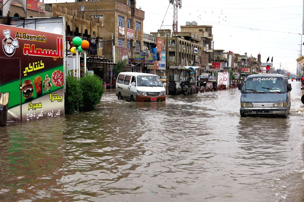 Vehicles are seen on a flooded street in Baghdad, Iraq, Oct. 29, 2015. Torrential rains caused chaos across several parts of Iraq on Wednesday and Thursday, ...