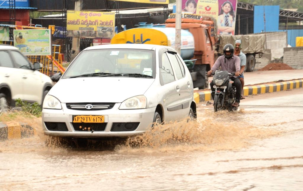 Vehicles move through a water-logged street as heavy rains lashed Hyderabad on July 12, 2018.