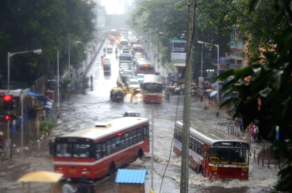 Vehicles move through the flooded Dadar TT Circle during heavy rains, in Mumbai on July 10, 2018.