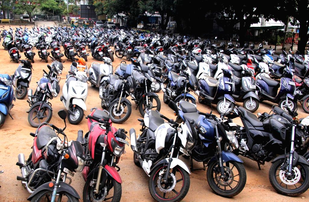 Vehicles of curfew violaters seized by the police parked at Bengaluru's Raja Rajeshwari Nagar during the extended nationwide lockdown imposed to mitigate the spread of coronavirus; on Apr ...