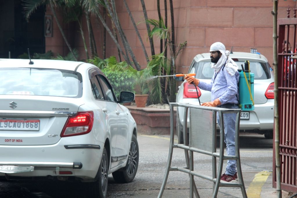 Vehicles of Government employees at Delhi's Rail Bhavan being sanitised during the extended nationwide lockdown imposed to mitigate the spread of coronavirus; on Apr 23, 2020.