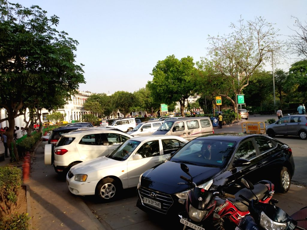 Vehicles parked at Connaught Place in New Delhi on April 10, 2019.