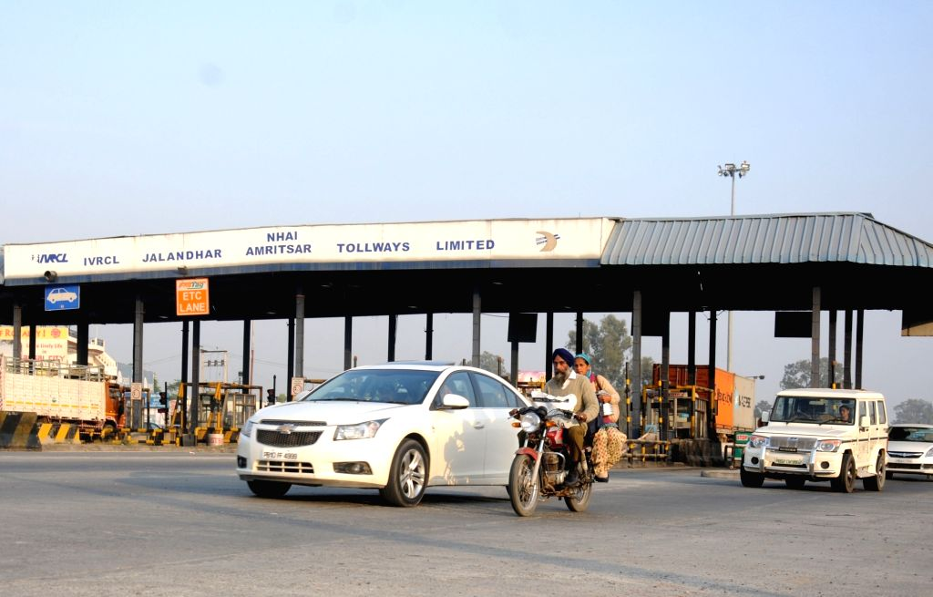 Vehicles pass through the toll gates in Amritsar on Nov. 18, 2016. Collection of toll tax were suspended on national highways till Nov 24 by the central government due to Rs 500 and 1,000 ...