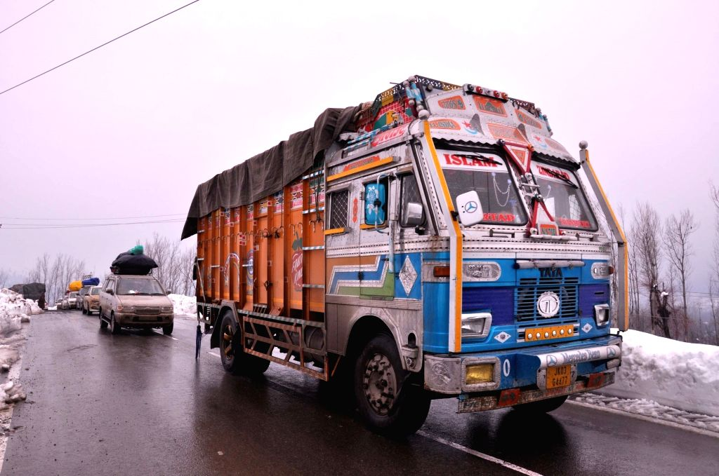 Vehicles ply on Jammu-Srinagar highway that was restored for one-way traffic after seven days following avalanches and landslides, in Qazigund on Feb 13, 2019.