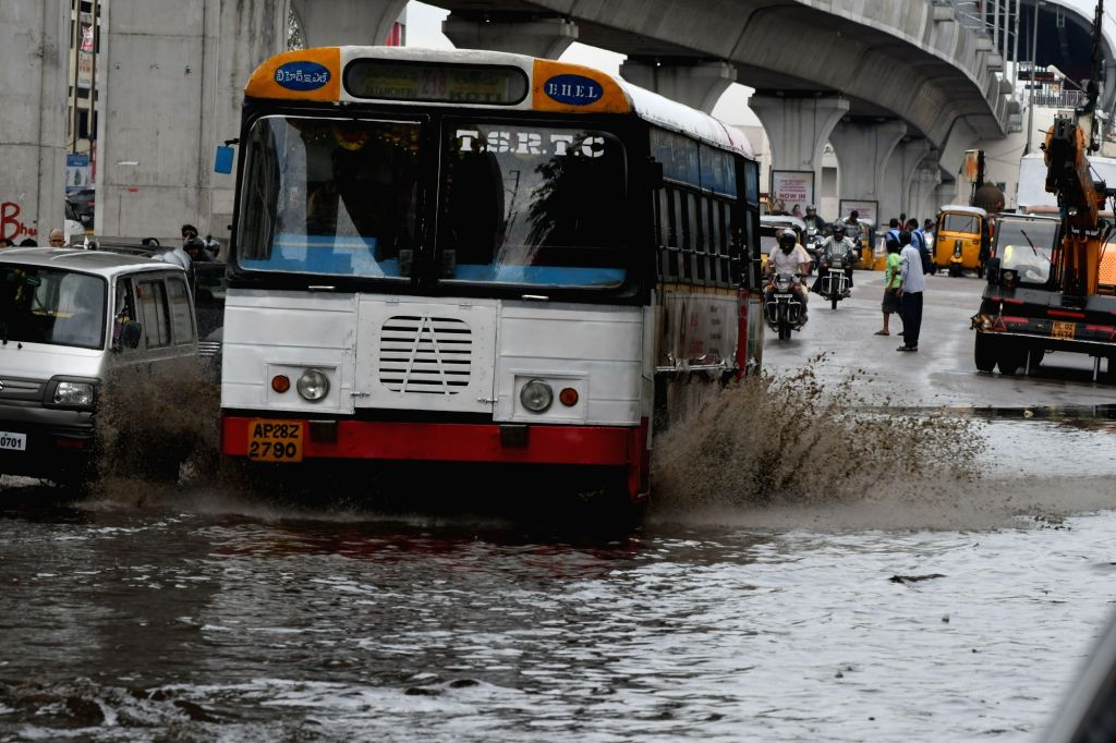 Vehicles ply on water logged roads of Hyderabad on July 26, 2016.