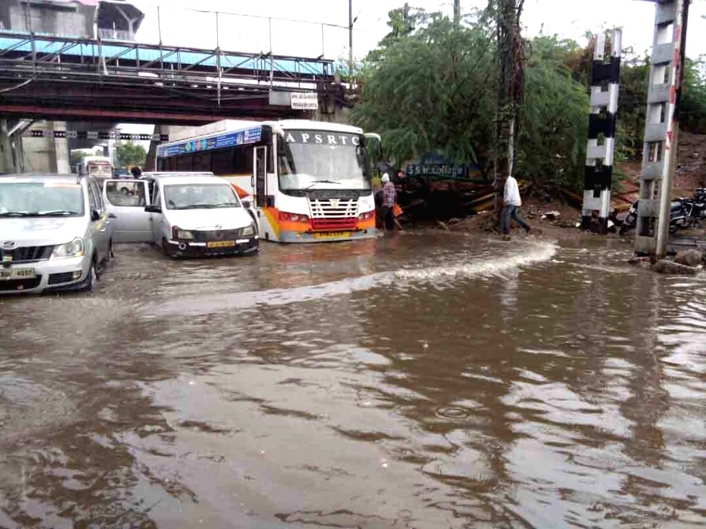 Vehicles ply on water logged roads of Hyderabad after heavy rains on June 8, 2017.