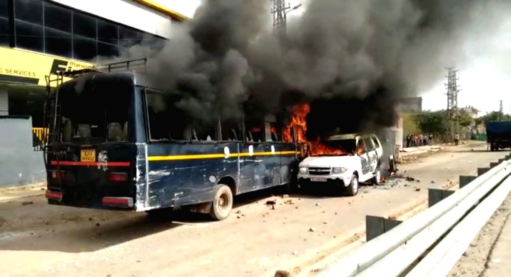 Vehicles set ablaze by an irate mob after Gujjar stir turned violent in Dholpur of Rajasthan on Feb 10, 2019.