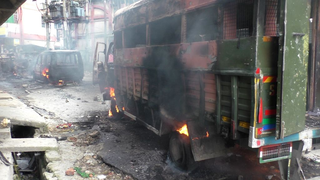 Vehicles set on fire by GJM supporters during a Gorkha Janamukti Morcha (GJM) indefinite shutdown in the northern Bengal hills; in Darjeeling on June 17, 2017.
