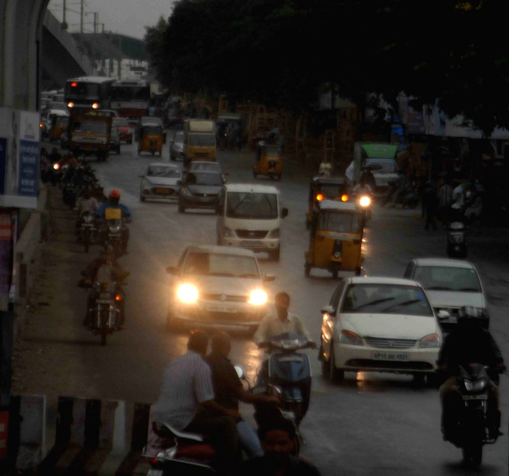 Vehicles struggle through low visibility as dark clouds cover the skies in Hyderabad on Sept 6, 2017.