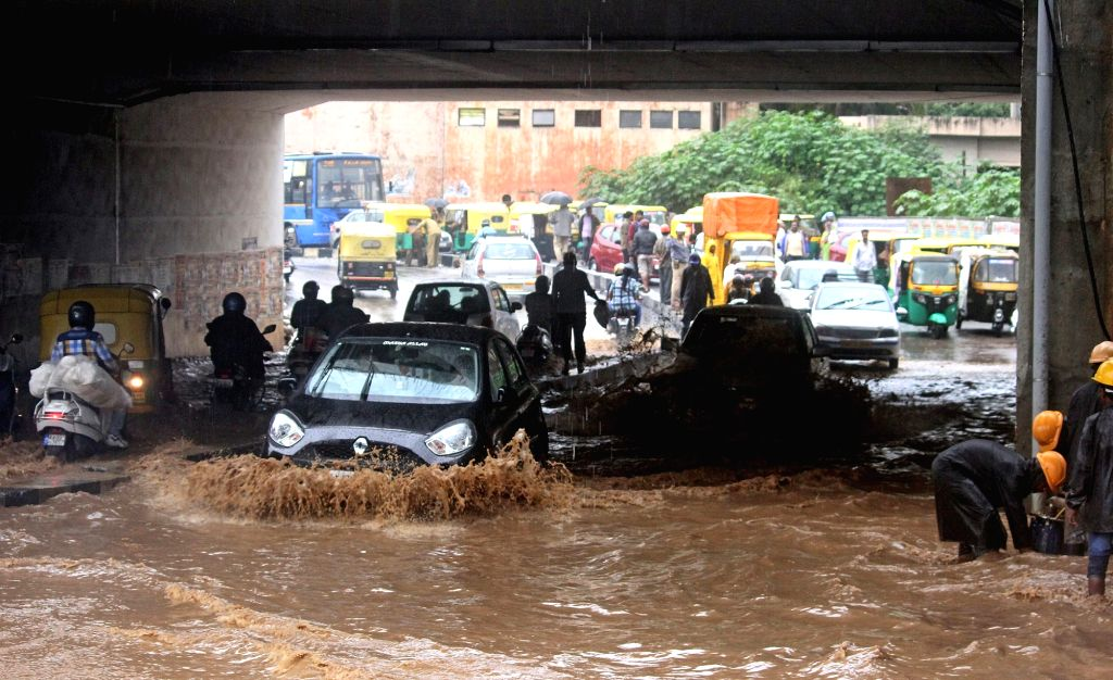 Vehicles struggle through the water logged streets of Bengaluru after heavy rains on Oct 5, 2017.