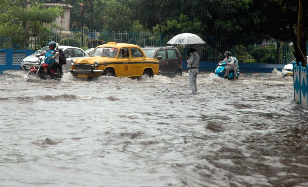 Vehicles struggle through water logged roads of Kolkata on July 7, 2017.