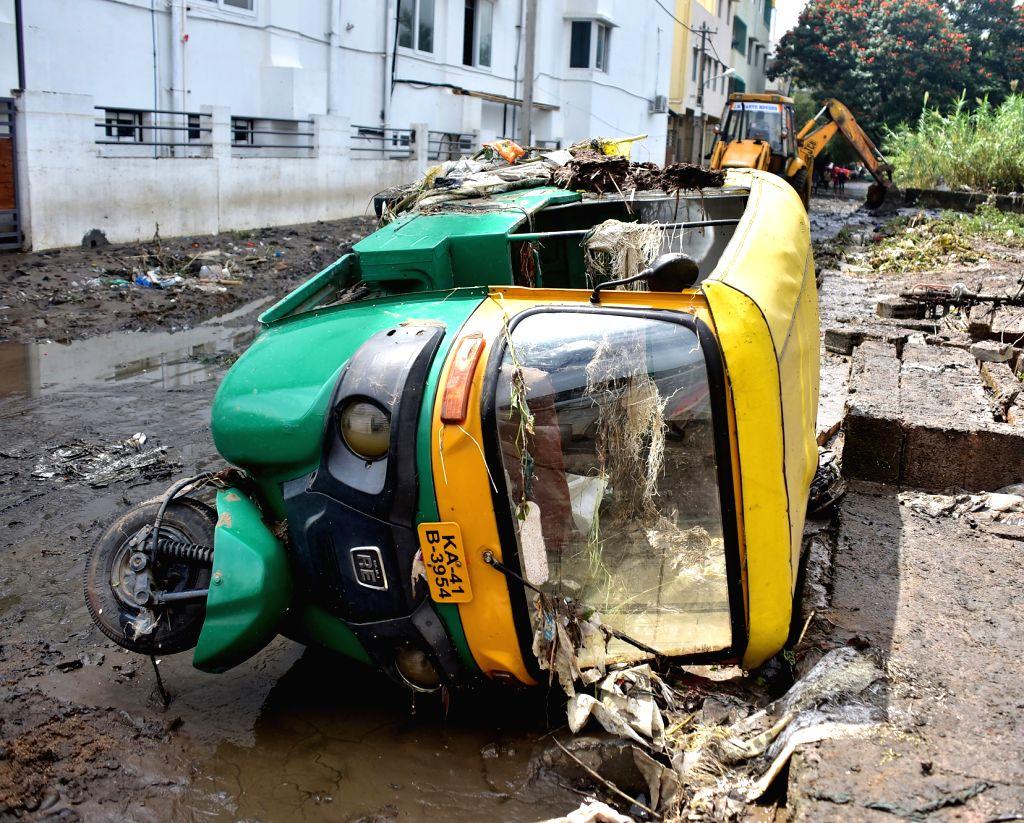 Vehicles toppled away due to flood at RR Nagar , after last night heavy rainfall,in Bengaluru on Monday 20th September 2021 .(PHOTO:IANS/Dhananjay Yadav) - Dhananjay Yadav