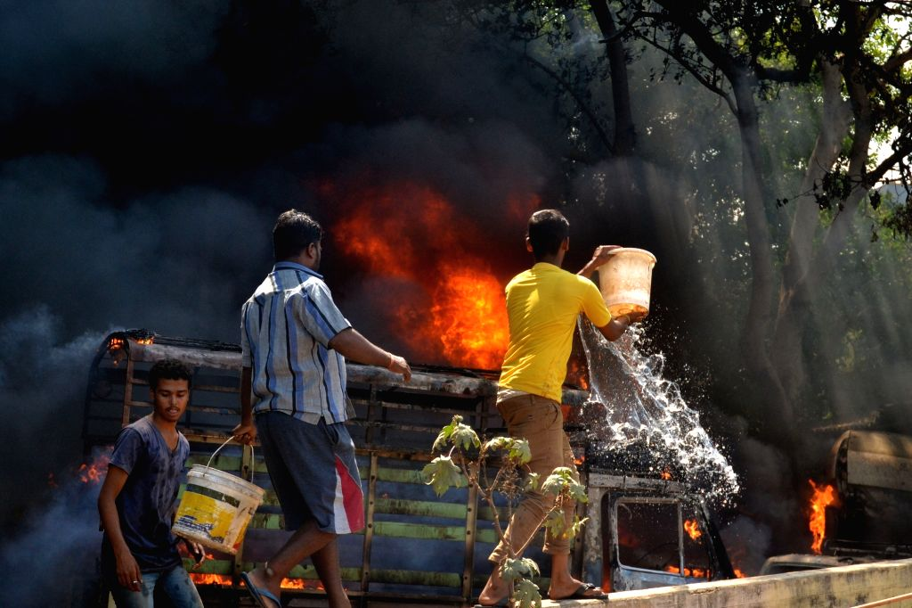 Vehicles torched during garment factory workers demonstration to protests against amendment in Employees Provident Funds and Miscellaneous Provisions Act, 1952 in Bengaluru, on April 19, ...