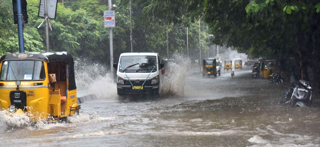 Vehicles wade through a water-logged road during rains in Hyderabad on Aug 1, 2020.