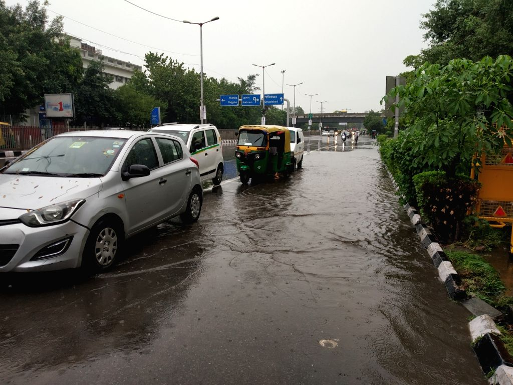 Vehicles wade through a water-logged road during rains in New Delhi on Aug 6, 2019.