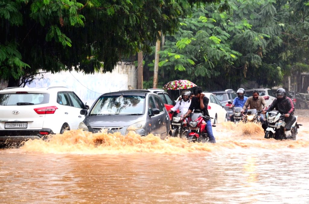 Vehicles wade through a water-logged street during rains in Hyderabad on Sep 30, 2019.