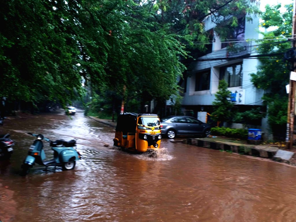Vehicles wade through a water-logged street during rains in Hyderabad, on Oct 8, 2019.