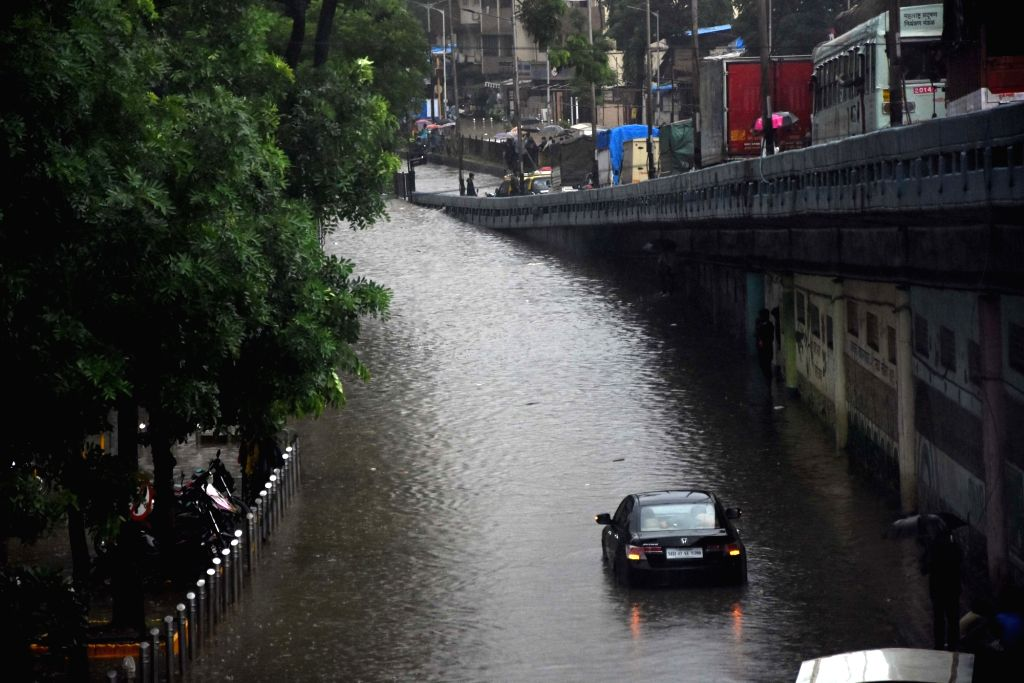 Vehicles wade through a water-logged street after heavy rains, in Mumbai on Sep 4, 2019.