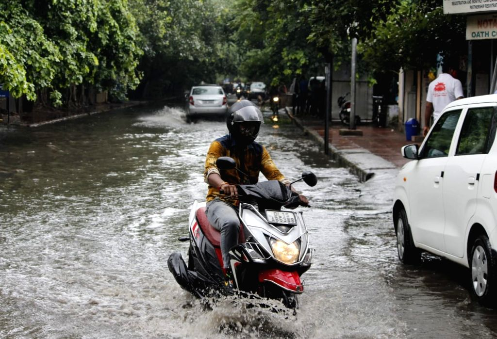 Vehicles wade through the waterlogged roads of Delhi after the national capital received heavy monsoon showers, on Aug 13, 2020.