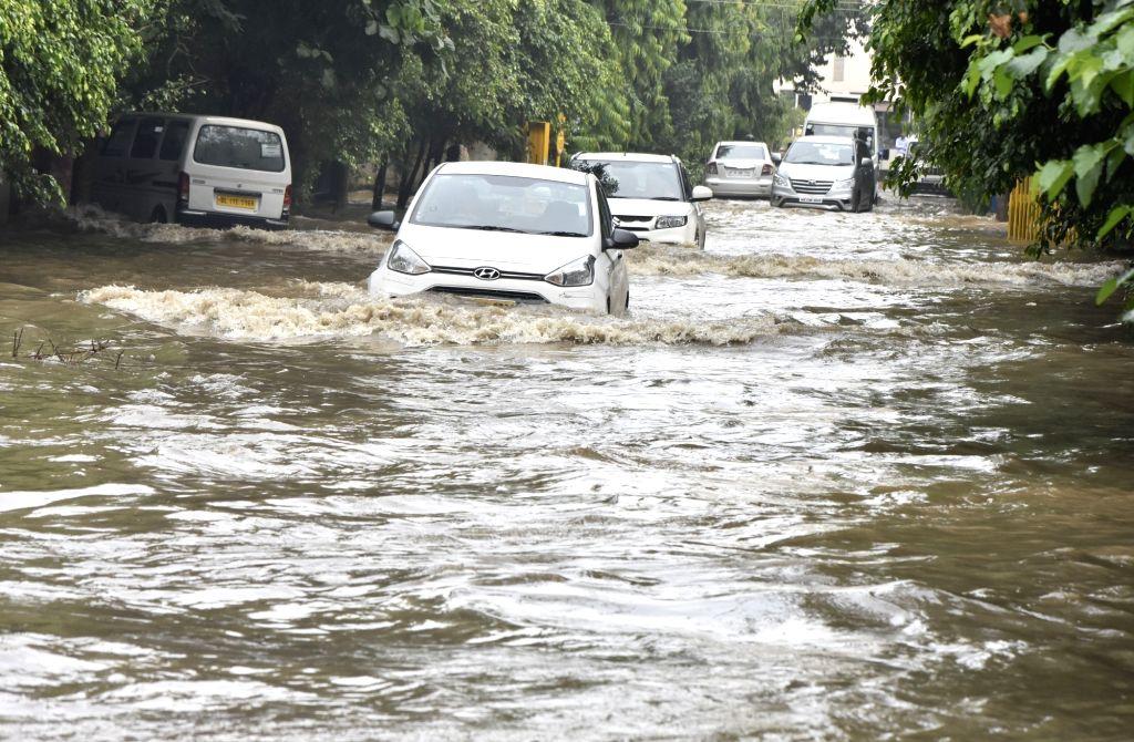 Vehicles wade through waterlogged streets of Gurugram on Aug 9, 2017.
