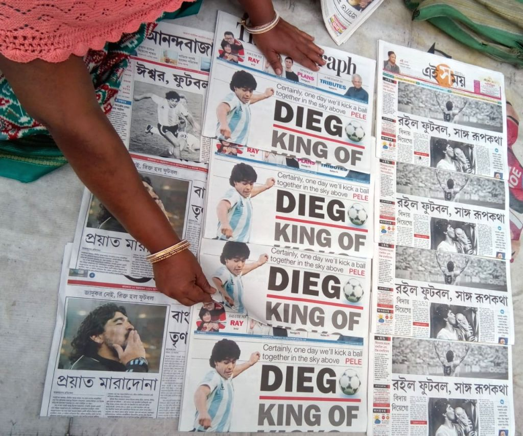 Vendor arrange News papers of Maradona in Kolkata on Nov 26, 2020.