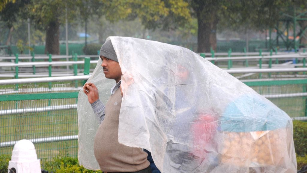 Vendors during the rain at India Gate in New Delhi.