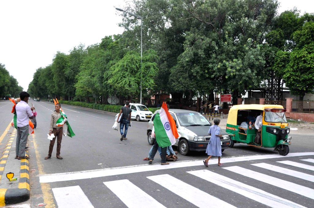 Vendors selling tricolors ahead of Independence Day in New Delhi on Aug 12, 2017.