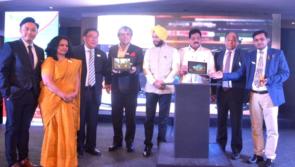 "Venezuelan Ambassador to India Augusto Montiel with Josh President Sunita Gupta and Alco International MD Yick Ka Lei at the launch of ""Venturer LapTAB"" in New Delhi on May 16, ... - Sunita Gupta"