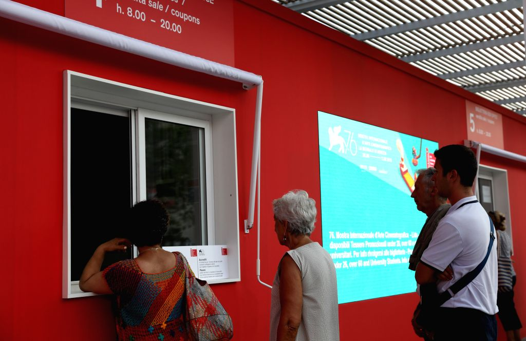 VENICE, Aug. 27, 2019 - People wait in line to buy film tickets for the 76th Venice International Film Festival in Venice Lido, Italy, on Aug. 27, 2019. The 76th Venice International Film Festival ...