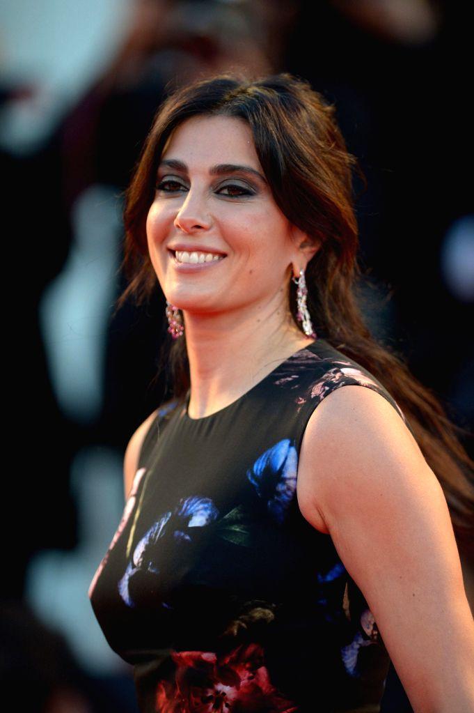 "Actress Nadine Labaki poses on the red carpet for the selected film for main competition ""La Rancon La Gloire"" during the 71th Venice Film Festival, in ... - Nadine Labaki"