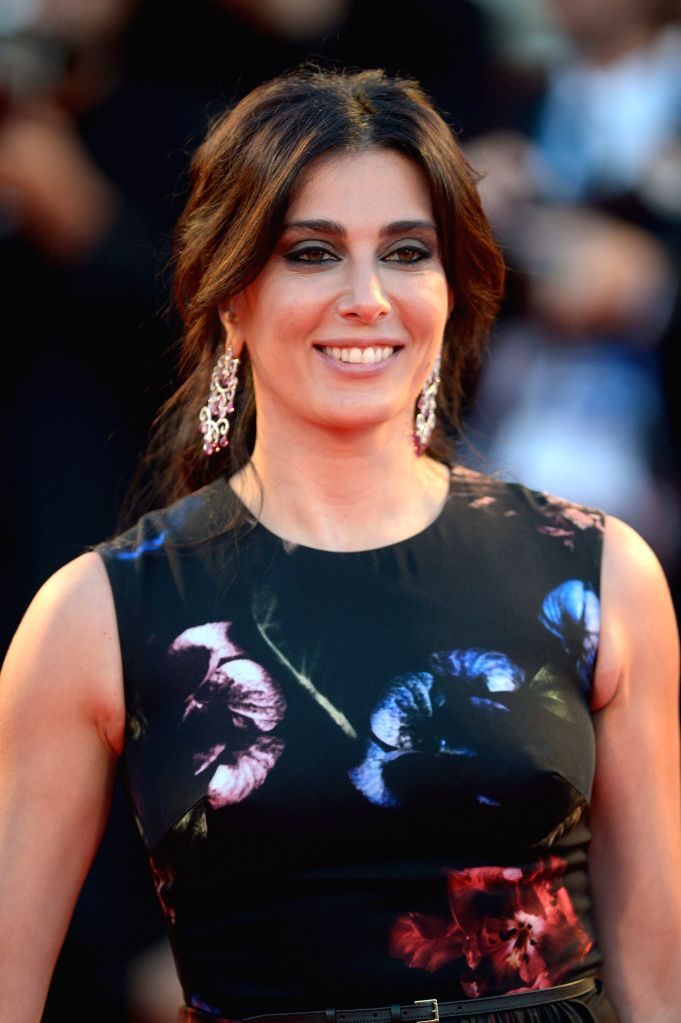 "Actress Nadine Labaki poses on the red carpet for the selected film for main competition ""La Rancon de La Gloire"" during the 71st Venice Film Festival, in . - Nadine Labaki"