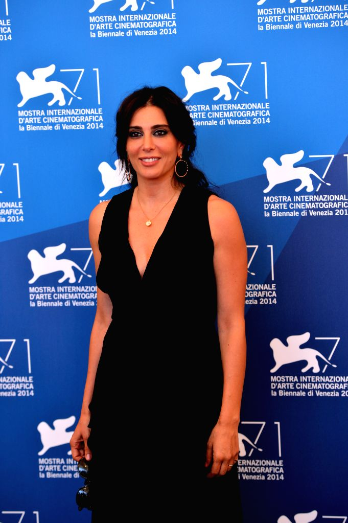 """Actress Nadine Labaki poses during the photocall for the selected film for main competition """"La Rancon de La Gloire"""" during the 71st Venice Film Festival, . - Nadine Labaki"""