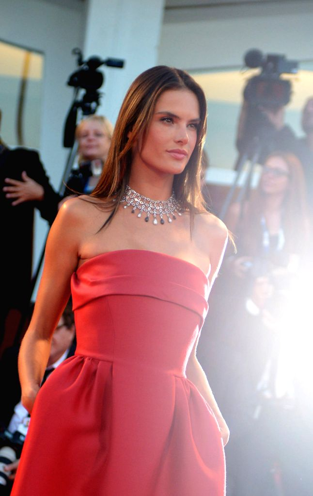 """Brazilian model Alessandra Ambrosio poses on the red carpet for the selected film for main competition """"La Rancon La Gloire"""" during the 71th Venice Film ... - Alessandra Ambrosio"""
