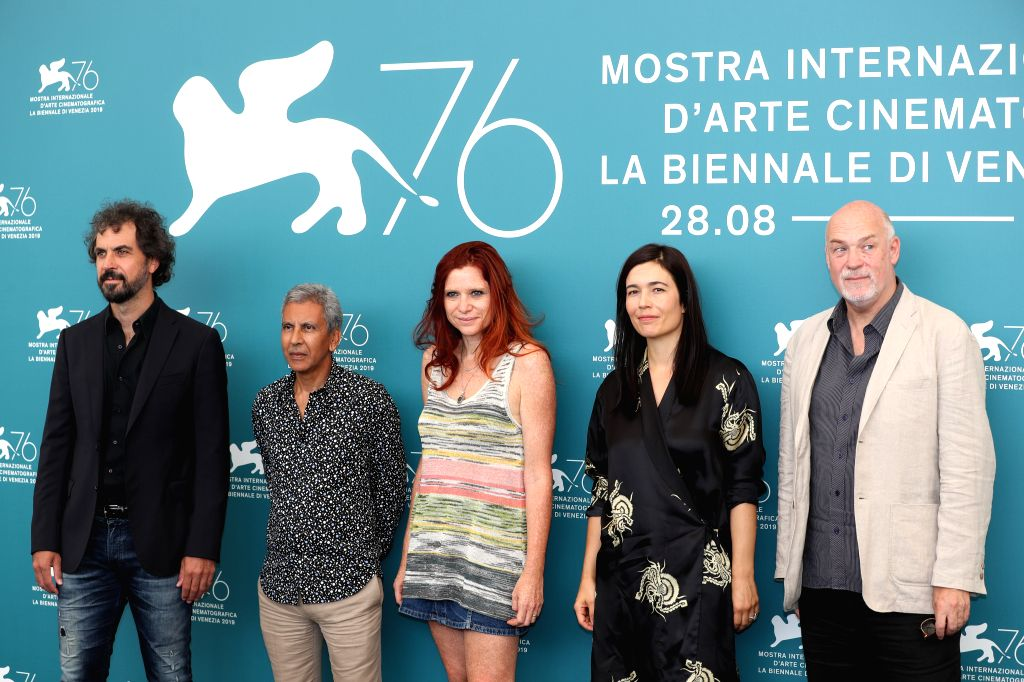 """VENICE, Aug. 28, 2019 - """"Horizons"""" jury president Susanna Nicchiarelli (C) and other jury members pose for photos during a photocall at the 76th Venice International Film Festival in ..."""