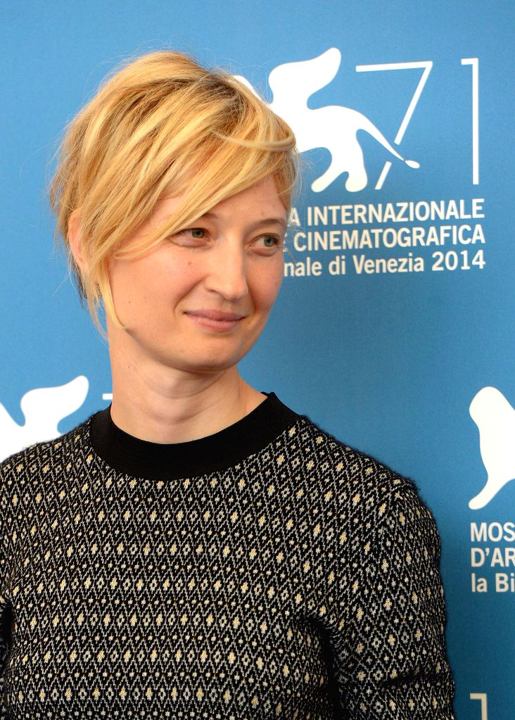 """Actress Alba Rohrwacher poses during the photo call for """"Hungry Hearts"""" which is selected for the main competition during the 71th Venice Film Festival, in - Alba Rohrwacher"""