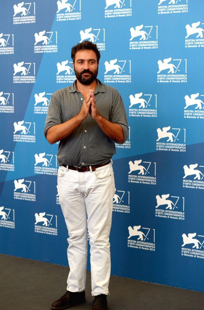 """Director Saverio Costanzo poses during the photo call for """"Hungry Hearts"""" which is selected for the main competition during the 71th Venice Film Festival, ."""