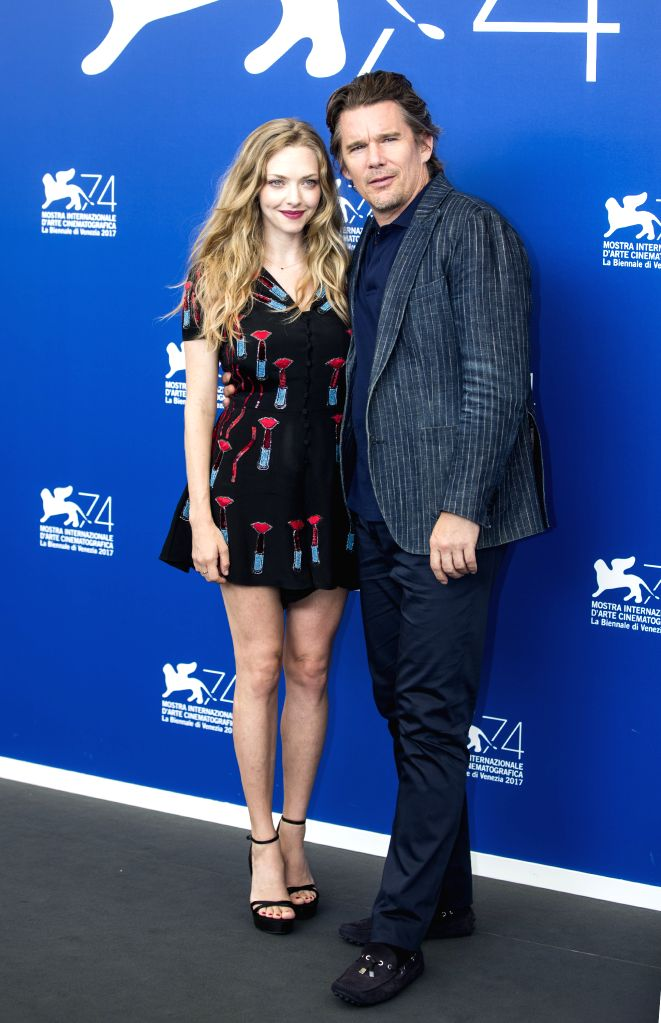 """VENICE, Aug. 31, 2017 - Actor Ethan Hawke (R) and actress Amanda Seyfried pose during a photocall for the movie """"First Reformed"""" at the 74th Venice Film Festival in Venice, Italy, on Aug. ... - Ethan Hawke"""