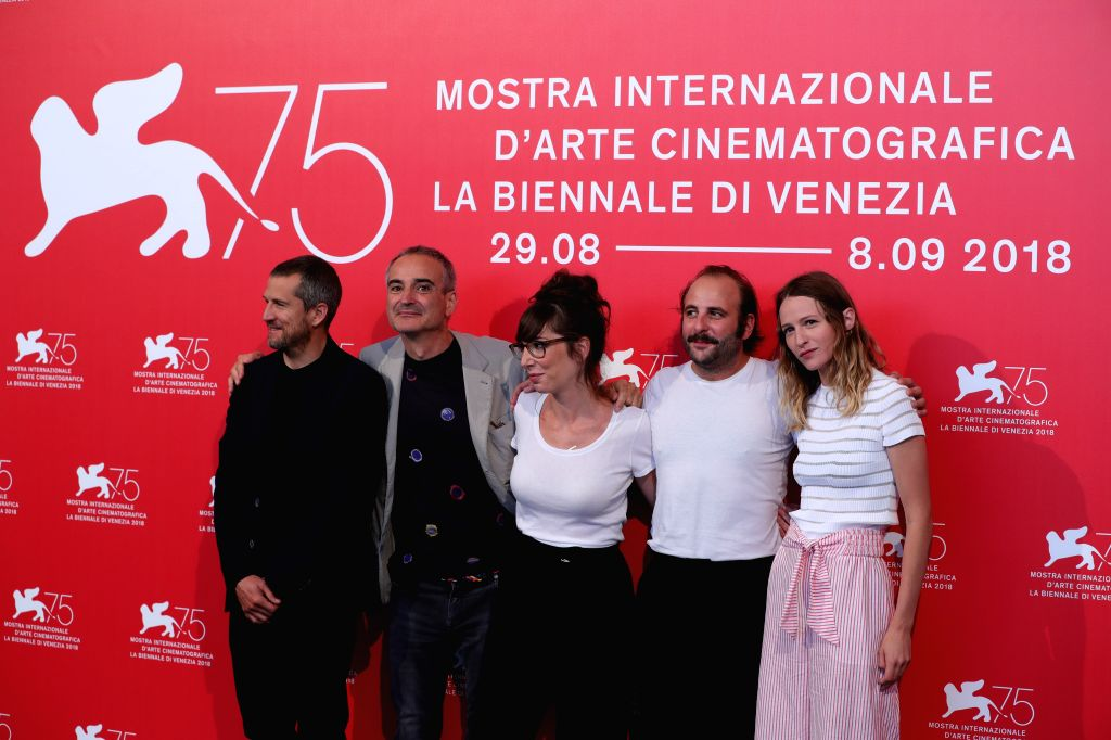 """VENICE, Aug. 31, 2018 - Guillaume Canet, Olivier Assayas, Nora Hamzawi, Vincent Macaigne and Christa Theret (L to R) attend """"Doubles Vies"""" photocall during the 75th Venice International ..."""
