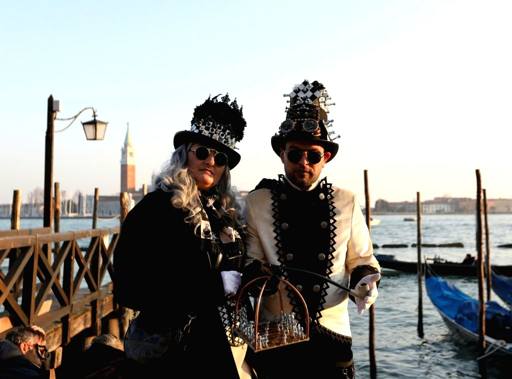 VENICE (ITALY), Feb. 17, 2019 Revelers pose during the Venice Carnival in Venice, Italy, on Feb. 17, 2019. The Venice Carnival 2019 kicked off on Saturday and will last until March 5.