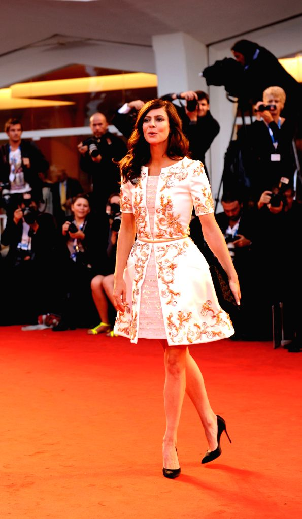 """Actress Anna Mouglalis poses on the red carpet for """"Il giovane favoloso"""" which is selected for the main competition during the 71st Venice Film Festival, .. - Anna Mouglalis"""